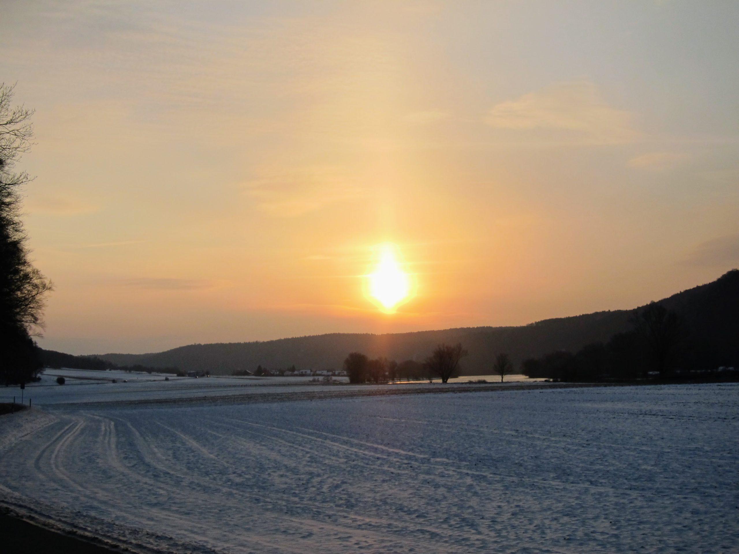 Coucher de soleil neige